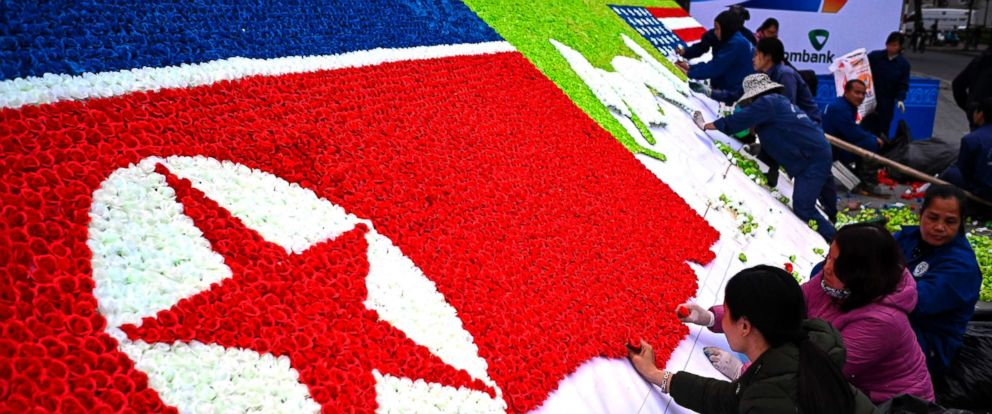 PHOTO: Workers make a North Korean and a U.S. flag out of paper-flowers beside a street in Hanoi on Feb. 25, 2019, ahead of the second US-North Korea summit.