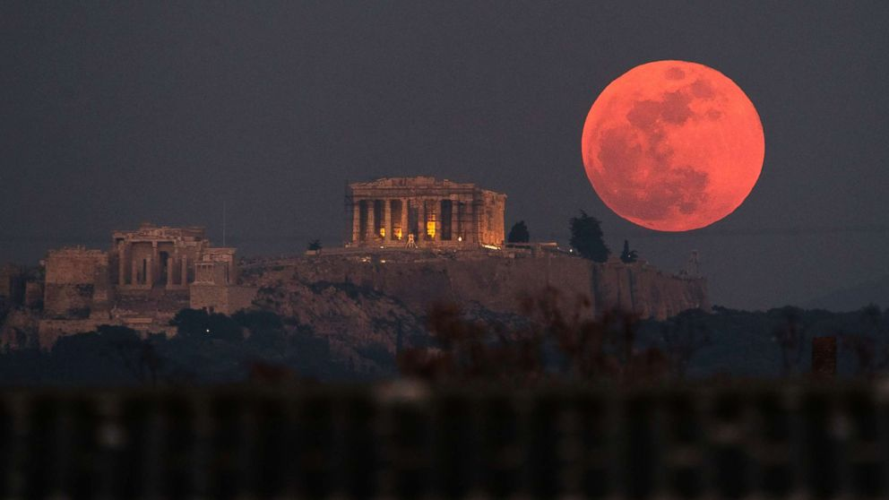 A super blue blood moon rises behind the 2,500-year-old Parthenon temple on the Acropolis of Athens, Greece, on Jan. 31, 2018.
