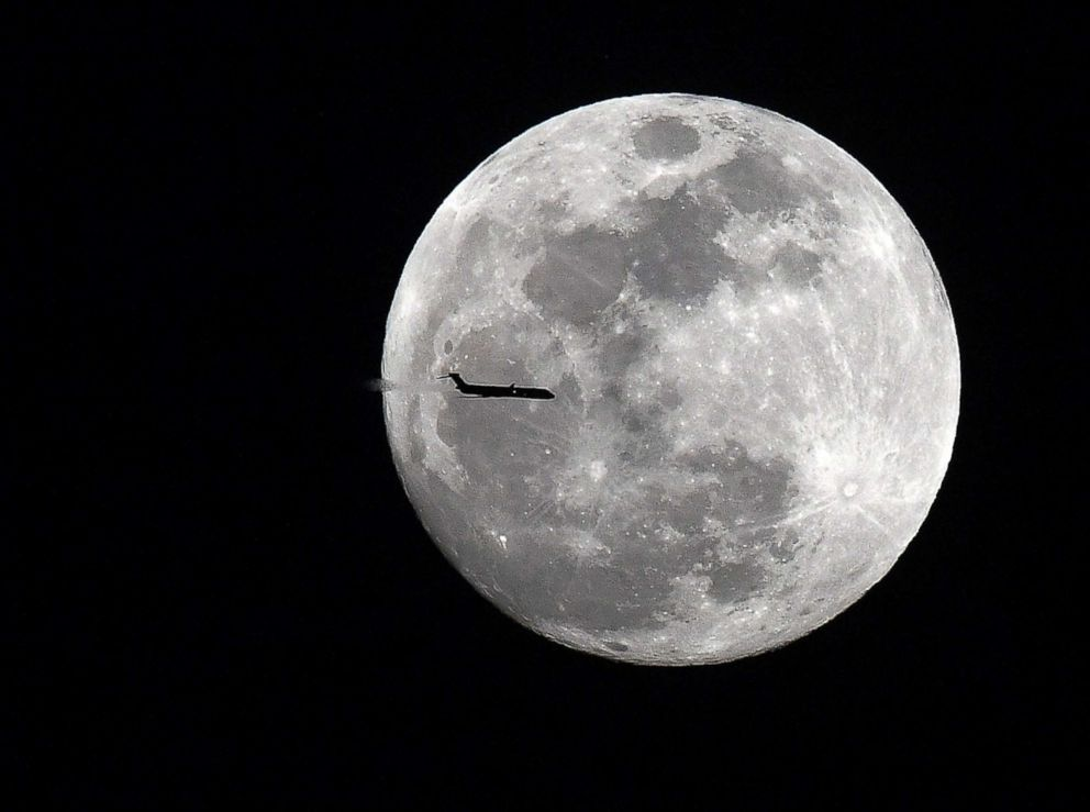 PHOTO: An aircraft from Atlanta to Jacksonville transits across the super moon over the evening sky in Ga., Jan. 30, 2018.