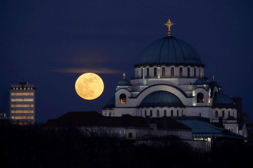 PHOTO: A full moon rises behind St. Sava temple in Belgrade, Serbia, on Jan 31, 2018.