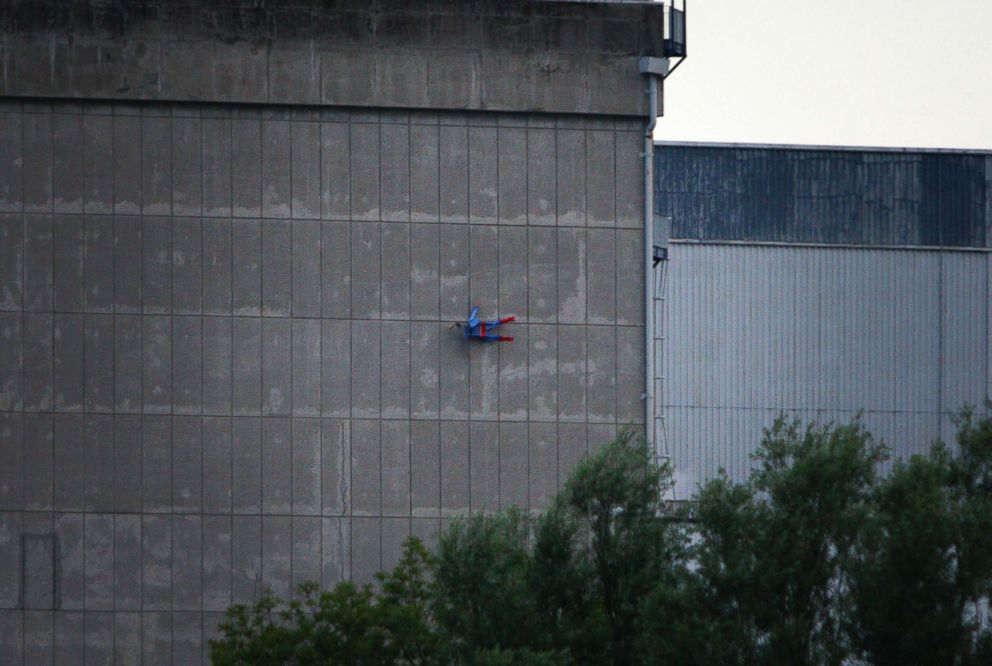 PHOTO: In this photo released by Greenpeace, a drone resembling the character of Superman flies over the nuclear power plant of Le Bugey, central, France, July 3, 2018.