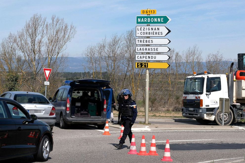 PHOTO: French police block the access to Trebes, where a man took hostages at a supermarket, March 23, 2018 in Trebes, France.