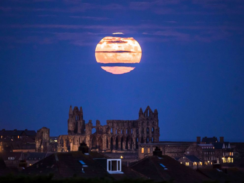 PHOTO: The Supermoon rises above Whitby Abbey in Whitby, north east England, Sunday Dec. 3, 2017.
