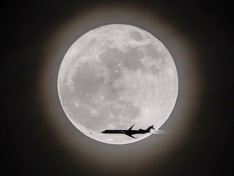 PHOTO: An airplane crosses in front of the moon, a supermoon, in Avondale Estates, Georgia, Dec.3, 2017.