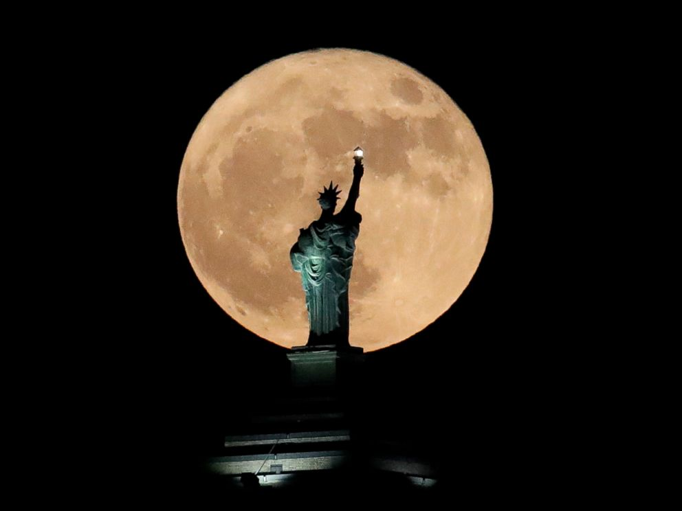PHOTO: A supermoon rises in front of a replica of the Statue of Liberty sitting atop the Liberty Building in downtown Buffalo, N.Y., Dec. 3, 2017.