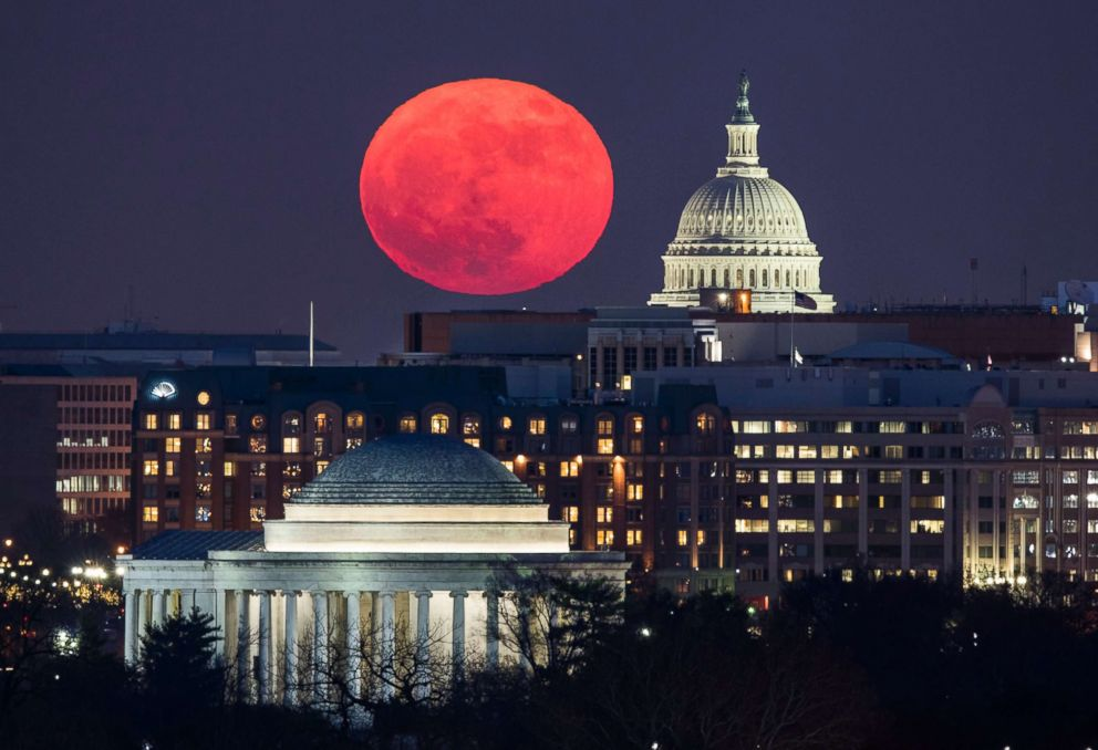 PHOTO: A supermoon rises behind the U.S. Capitol and the Jefferson Memorial, in Washington, D.C., viewed from Arlington, Va., Dec. 3, 2017.