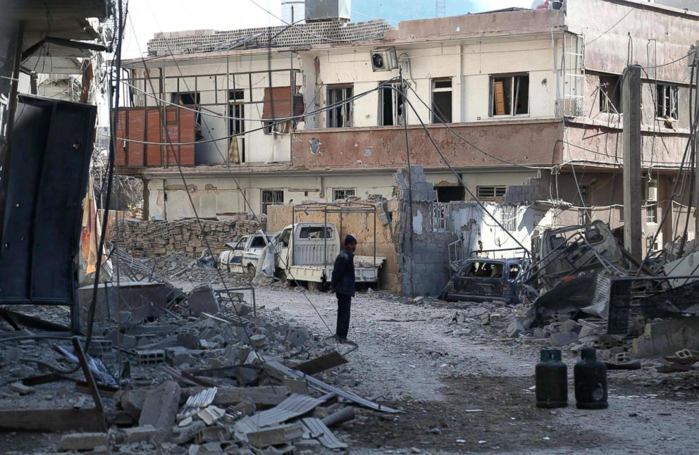 PHOTO: A Syrian man stands next to rubble in a heavily-damaged street after a reported regime air strike in the rebel-held enclave of Hamouria in the Eastern Ghouta near Damascus, Feb. 21, 2018.