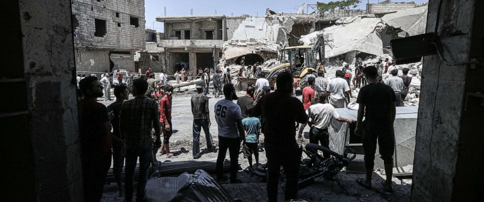 PHOTO: People conduct search and rescue operation after a residential area was hit by airstrikes in Urm al Juz village of Idlib, de-escalation zone, Syria on July 21, 2019.