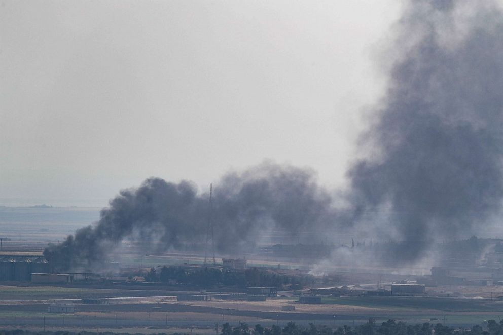 PHOTO: Smoke rises over the Syrian town of Ras al-Ain, as seen from the Turkish border town on October 18, 2019 in Ceylanpinar, Turkey.