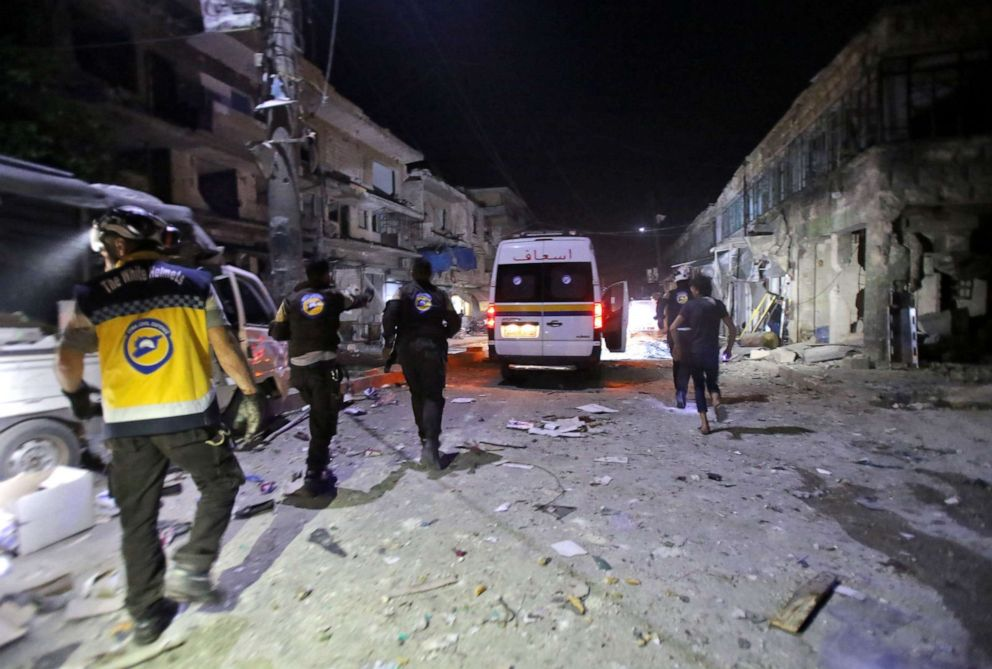 PHOTO: White Helmets rescue volunteers gather at the site of an air strike on a market in the town of Maarat al-Numan, May 21, 2019.At least 12 people were killed and 18 others wounded in overnight strikes on the Idlib town of Maarat al-Numan.