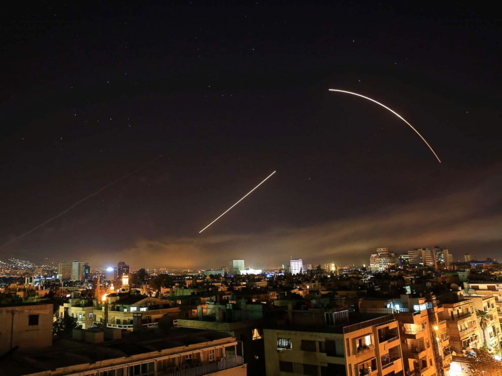 PHOTO: Missiles streak across the Damascus skyline as the U.S. launches an attack on Syria targeting different parts of the capital, early Saturday, April 14, 2018.