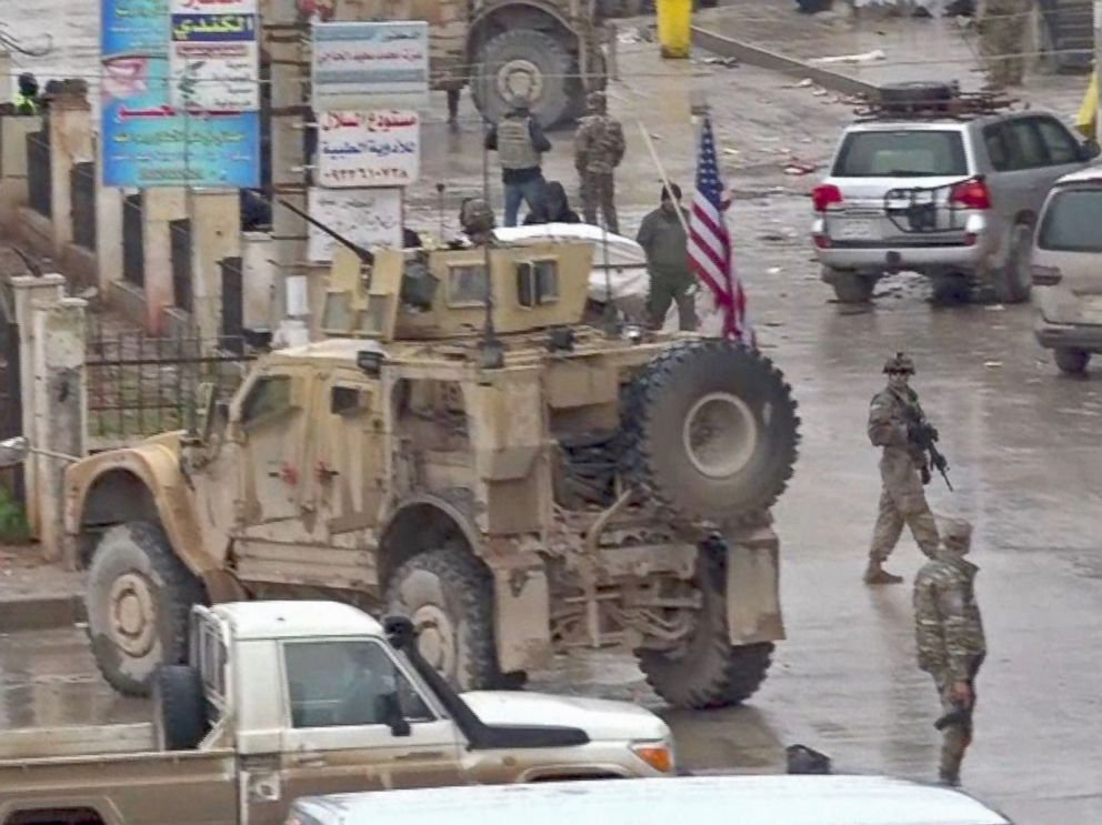 PHOTO: An image grab taken from a video obtained by AFPTV on Jan. 16, 2019, shows U.S. troops gathered at the scene of a suicide attack in the northern Syrian town of Manbij.