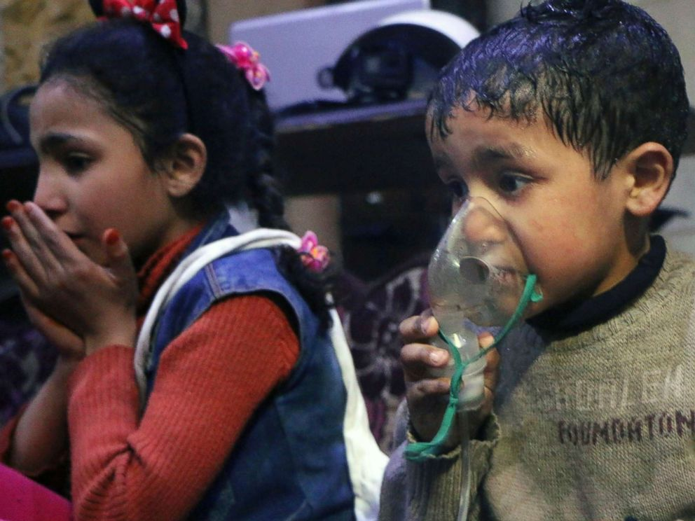 PHOTO: This image released early Sunday, April 8, 2018 by the Syrian Civil Defense White Helmets, shows a child receiving oxygen through respirators following an alleged poison gas attack in the rebel-held town of Douma, near Damascus, Syria.
