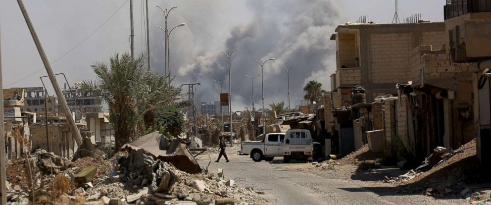 PHOTO: Smoke billows in Raqa on Sept. 4, 2017, as Syrian Democratic Forces battle to retake the northern Syrian city from the Islamic State group.