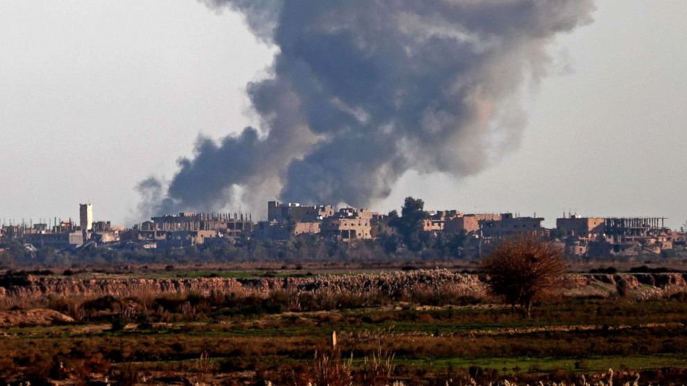 Smoke billows after bombings in the Deir Ezzor province, near Hajin, eastern Syria, on Dec. 15, 2018. Kurdish-led forces seized the Islamic State's main hub of Hajin on December 14, a milestone in a massive and costly US-backed operation to eradicate the jihadists from eastern Syria.
