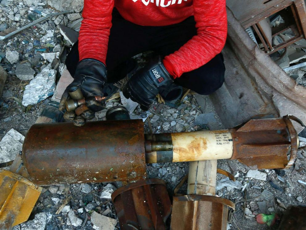 PHOTO: A Syrian man shows remnants of rockets reportedly fired by regime forces on the rebel-held besieged town of Douma, in the eastern Ghouta region, on the outskirts of the capital Damascus on Jan. 22, 2018.