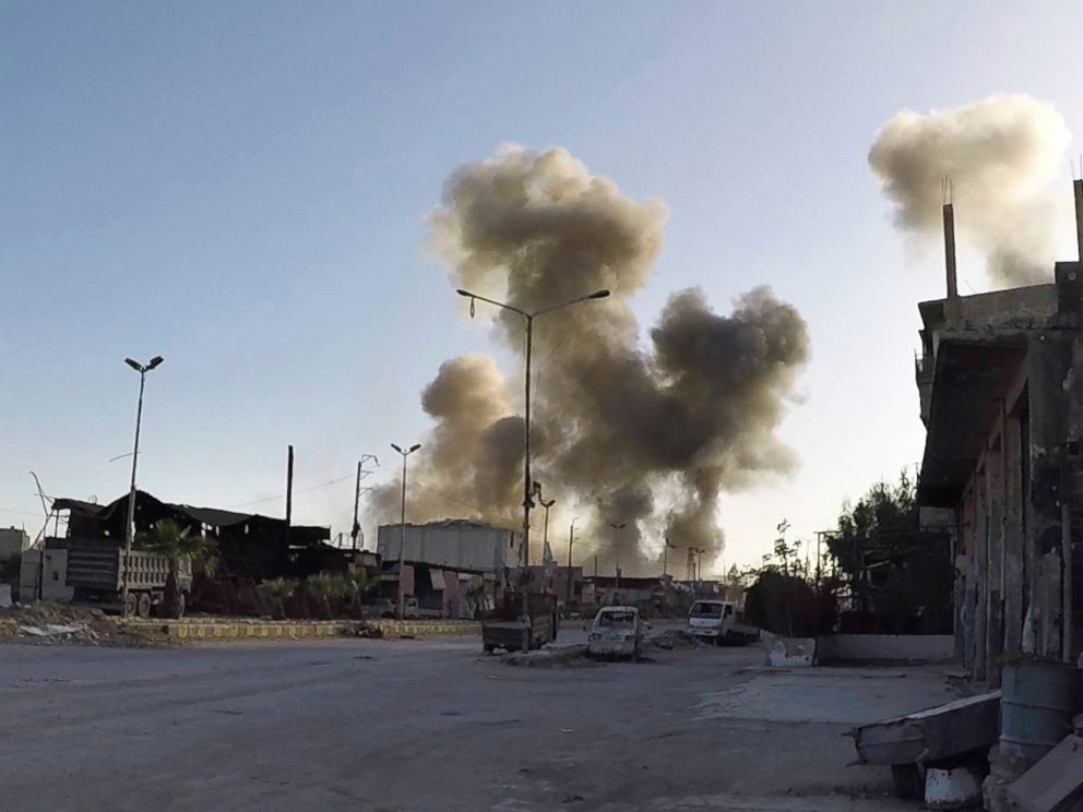 This photo released by the Syrian Civil Defense White Helmets, which has been authenticated based on its contents and other AP reporting, shows smoke rising after Syrian government airstrikes hit in the town of Douma, in Syria, Saturday, April. 7, 2018.