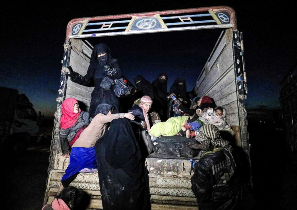 PHOTO: Women and children are seen at the back of a truck near the Omar oil field in the countryside of the eastern Syrian Deir Ezzor province, Jan. 25, 2019.
