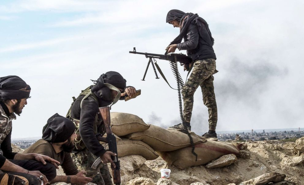 PHOTO: Fighters with the U.S.-backed Syrian Democratic Forces (SDF) keep position during an operation to expel ISIS jihadists from the Baghouz area in the eastern Syrian province of Deir Ezzor, Feb. 13, 2019.