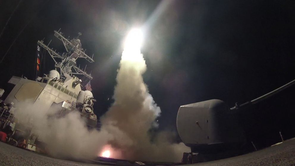 PHOTO: In this handout provided by the U.S. Navy,The guided-missile destroyer USS Porter fires a Tomahawk land attack missile at a Syrian military airfield in retaliation for a chemical attack that killed civilians, April 7, 2017.