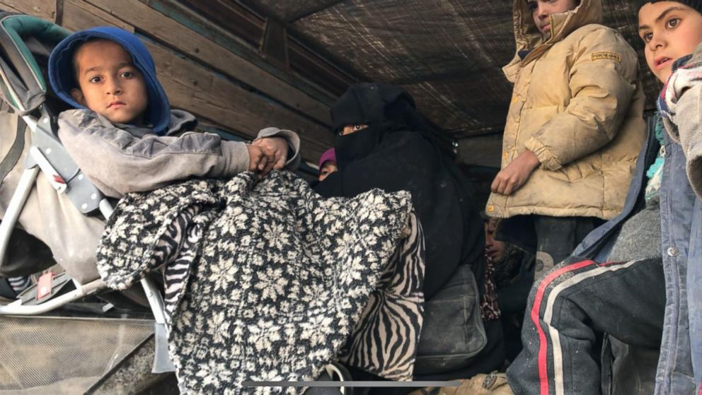 Children and women emerged from ISIS's final holdout in Baghouz, Syria, as fighting raged on March 13, 2019.
