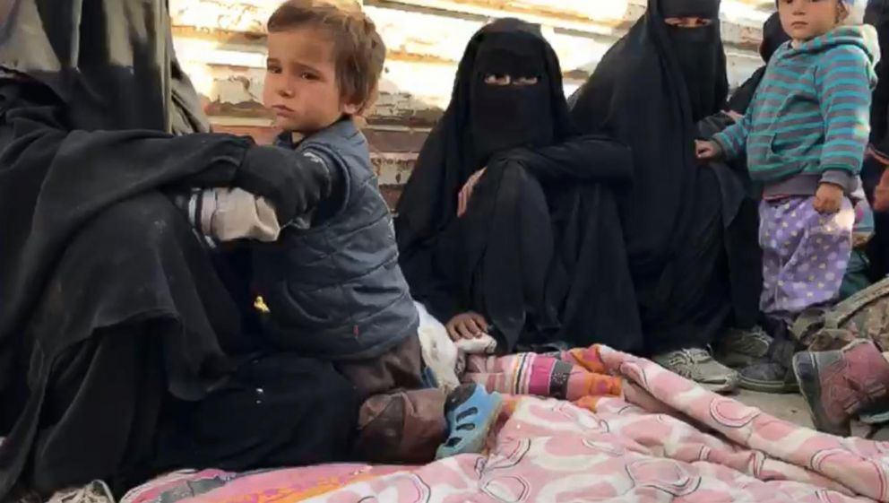 Women and children emerged from ISIS's final holdout in Baghouz, Syria, as fighting raged on March 13, 2019.