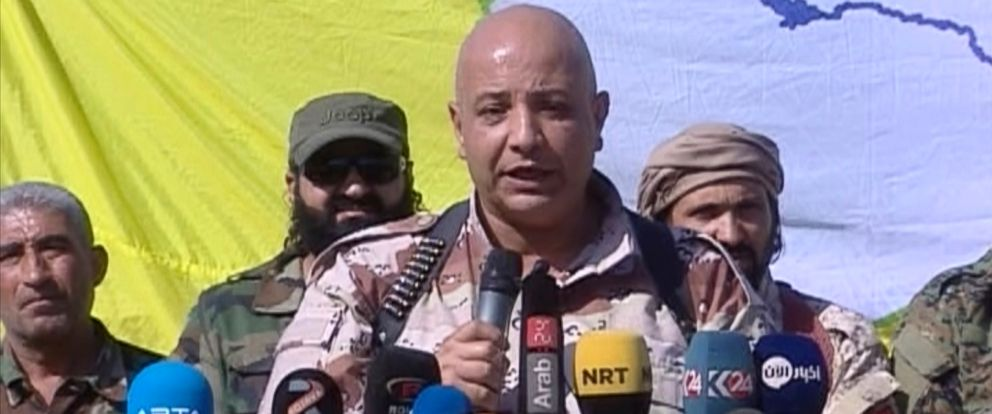 PHOTO: A Kurdish TV channel media outlet, that is consistent with independent AP reporting, shows Talal Sillo, a spokesman and senior SDF commander speaks during a press conference held inside Raqqa city, Syria, Oct. 20, 2017.