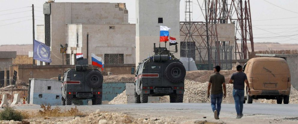 PHOTO: Russian and Syrian national flags flutter on military vehicles near Manbij, Syria Oct. 15, 2019.