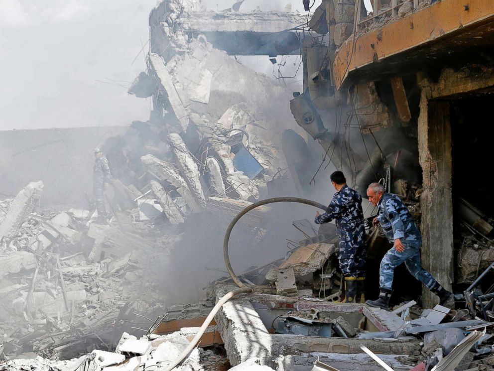 PHOTO: Syrian soldiers inspect the wreckage of a building described as part of the Scientific Studies and Research Center (SSRC) compound in Barzeh, north of Damascus, Syria, April 14, 2018.