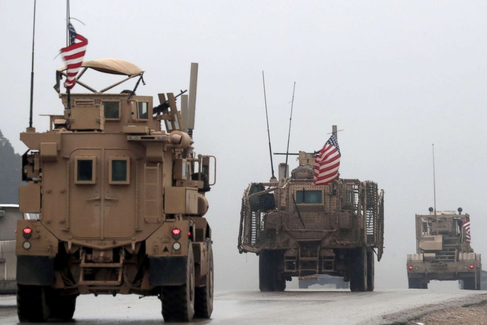 US military vehicles are seen in Syria's northern city of Manbij, Dec. 30, 2018.