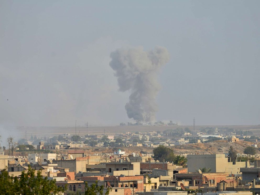 PHOTO: Smoke rises from the Syrian border town of Ras al-Ain as it is pictured from the Turkish town of Ceylanpinar in Sanliurfa province, Turkey, Oct. 9, 2019.