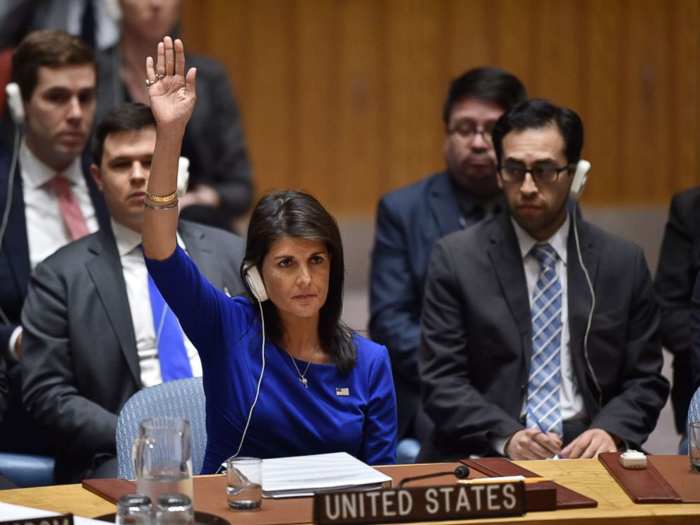 PHOTO: US Ambassador to the UN Nikki Haley votes during a UN Security Council meeting on the situation in Syria, at the United Nations Headquarters in New York, April 14, 2018. <p itemprop=