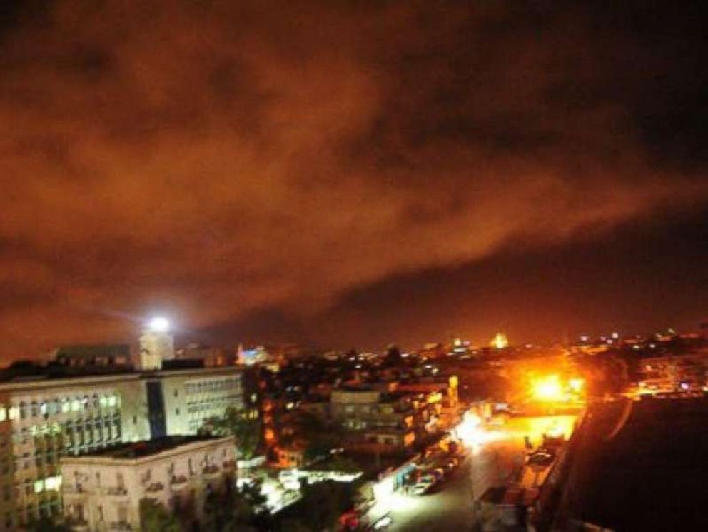 PHOTO: A photo released on April 14, 2018 the twitter page of the Syrian governments central military media on April 14, 2018 shows an explosion on the outskirts of Damascus.