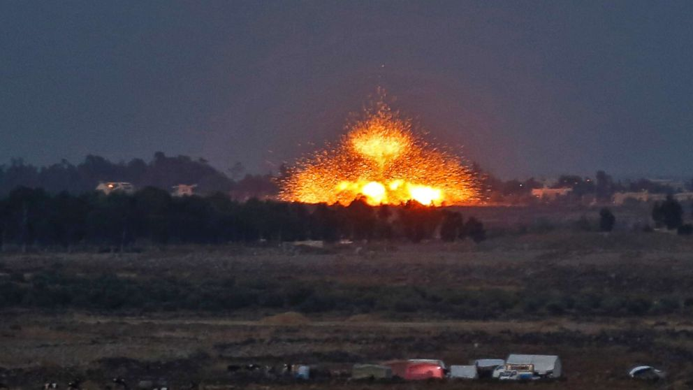 A picture taken on July 24, 2018 from the Tal Saki hill in the Israeli-annexed Golan Heights shows an explosion caused by aerial bombardment across the border in Syria, during air strikes backing a Syrian-government-led offensive in the southwestern province of Daraa.