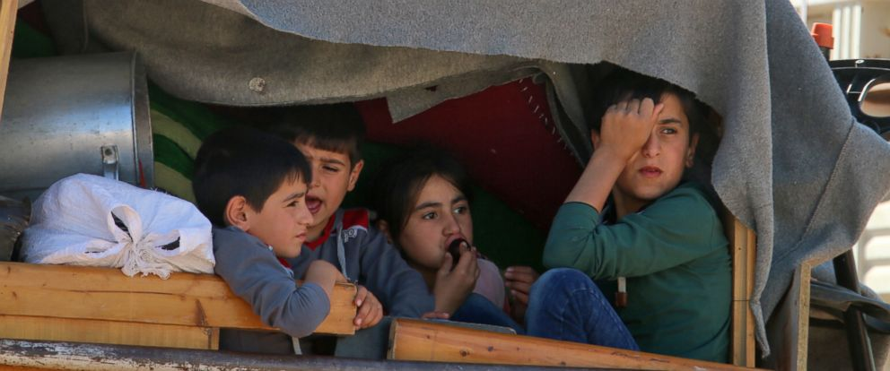 PHOTO: Syrian children ride a truck carrying their personal belongings at a Lebanese army checkpoint in Wadi Hmeid in the Bekaa valley, after leaving the village of Arsal to return to their homes in Syrias Qalamoun region on July 23, 2018.