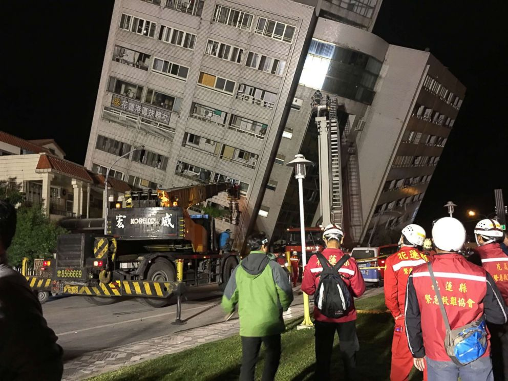 PHOTO: A damaged building is surrounded by first responders in Hualien, eastern Taiwan, after an earthquake hit Hualien on the night of Feb. 6, 2018.