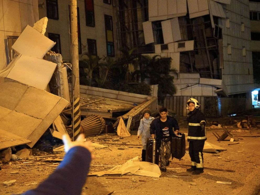 PHOTO: Two guests are escorted by rescue workers from the damaged Marshal Hotel in Hualien, eastern Taiwan early Feb. 7, 2018, after a strong earthquake struck the island.