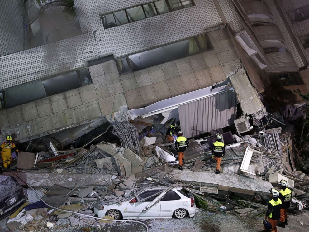 PHOTO: Rescuers search for people in a damaged building in Hualien, eastern Taiwan, Feb. 7, 2018, after a strong earthquake hit the island.