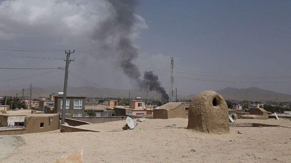 Smoke rising into the air after Taliban militants launched an attack on the Afghan provincial capital of Ghazni, Aug. 10, 2018. U.S. forces launched airstrikes on Aug. 10 to counter a major Taliban assault on an Afghan provincial capital, where terrified residents cowered in their homes amid explosions and gunfire as security forces fought to beat the insurgents back.