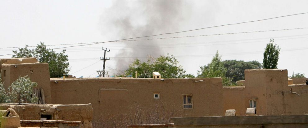 PHOTO: Smoke rises from a residential area where gun battle is going on between Taliban and Afghan forces in Ghazni province, Afghanistan, Aug. 10, 2018.