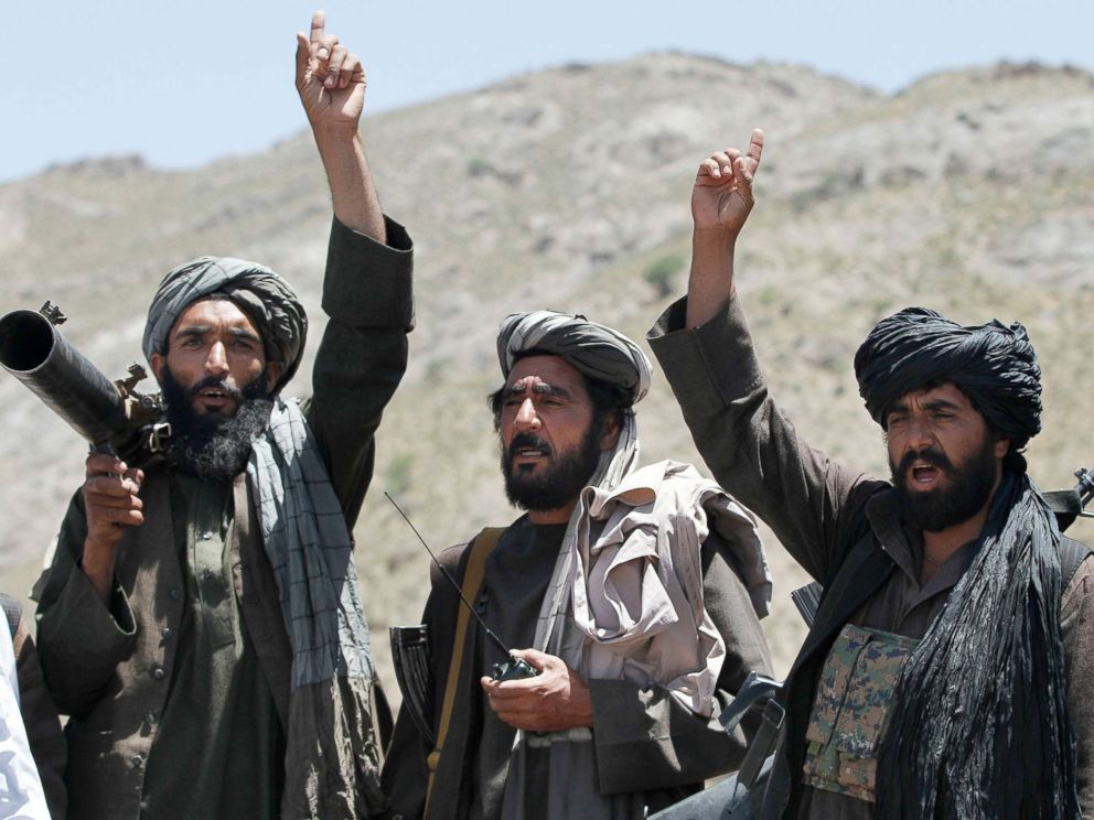 PHOTO: Taliban fighters react to a speech by a senior leader of a breakaway faction of the Taliban, Mullah Abdul Manan Niazi, in the Shindand district of Herat province, Afghanistan, May 27, 2016.