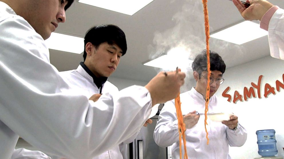 A team of Samyang Food researchers taste a new instant noodle in their lab.