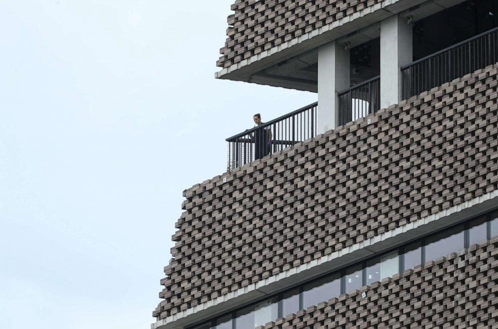 PHOTO: A police officer looks out from the viewing platform at the Tate Modern art gallery in London after a six-year-old boy was thrown from the tenth floor viewing platform, Aug. 4, 2019.