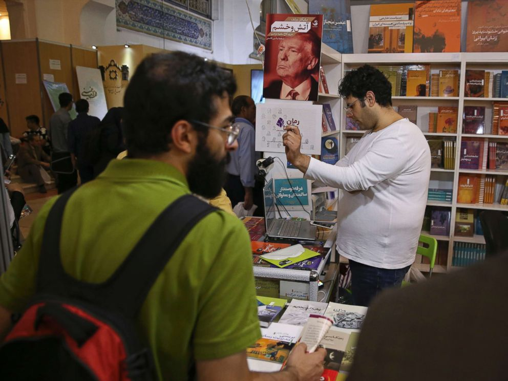 PHOTO: A poster advertising the farsi translation of the book, Fire and Fury, by Michael Wolff. is displayed at a booth at the International Book Fair, in Tehran, Iran, Tuesday, May. 8, 2018.