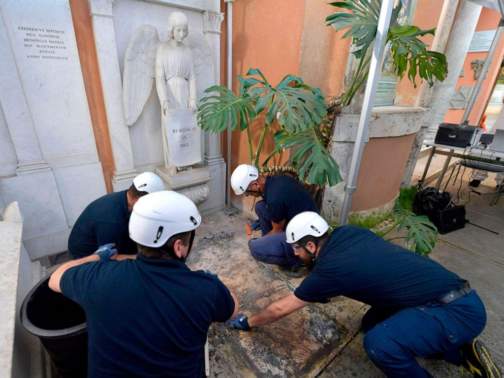 PHOTO: Workers open one of the two tombs within the Vaticans grounds in the Teutonic Cemetery, July 11, 2019, as part of a probe into the case of Emanuela Orlandi, a teenager who disappeared in 1983.