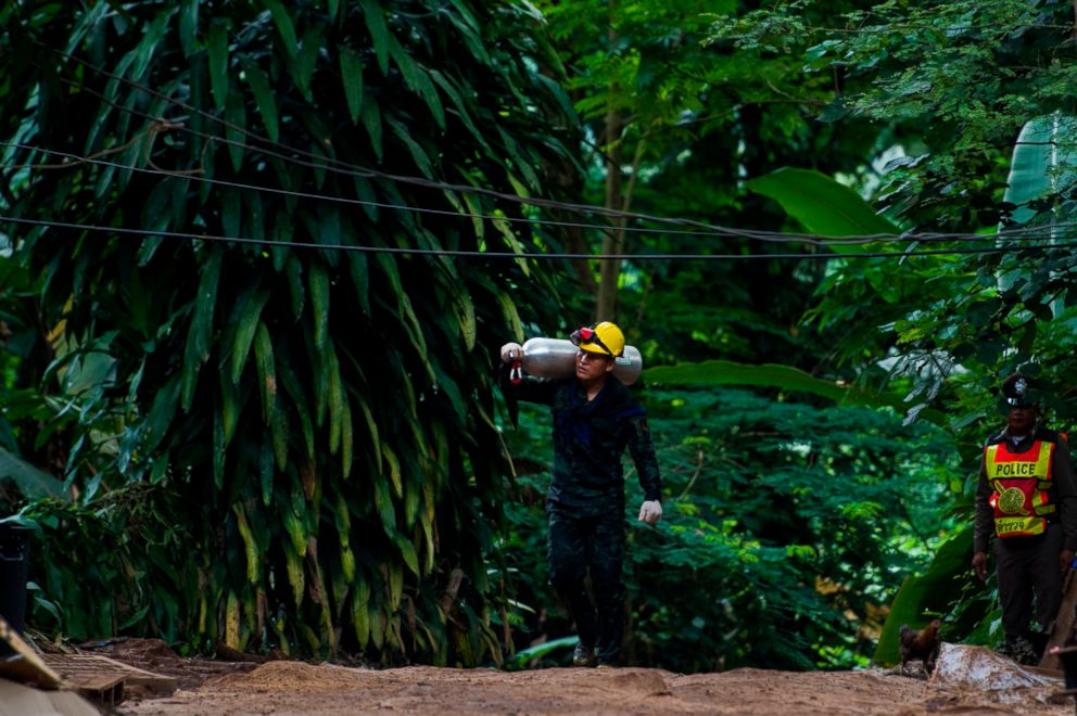 PHOTO: A Thai soldier carries an oxygen tank as rescue operations continue for the 12 boys and their football team coach trapped in Tham Luang cave at Khun Nam Nang Non Forest Park in the Mae Sai district of Chiang Rai province on July 7, 2018.