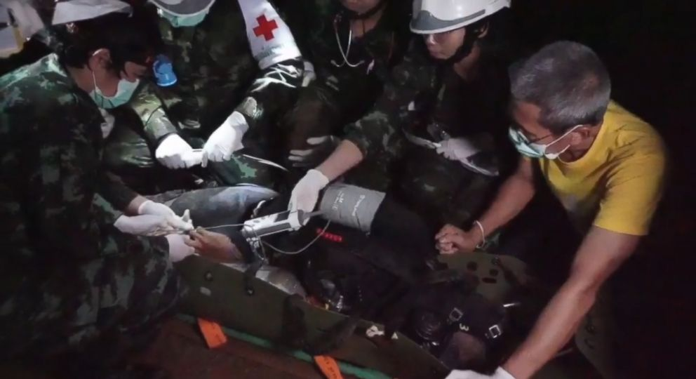 PHOTO: The rescued boys and coach get passed to a team of medics just inside the mouth of the cave ready to immediately treat the survivors as they are brought out of the labyrinth.