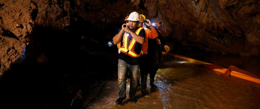 PHOTO: Rescue workers take out machines after 12 soccer players and their coach were rescued in Tham Luang cave complex in the northern province of Chiang Rai, Thailand, July 10, 2018.