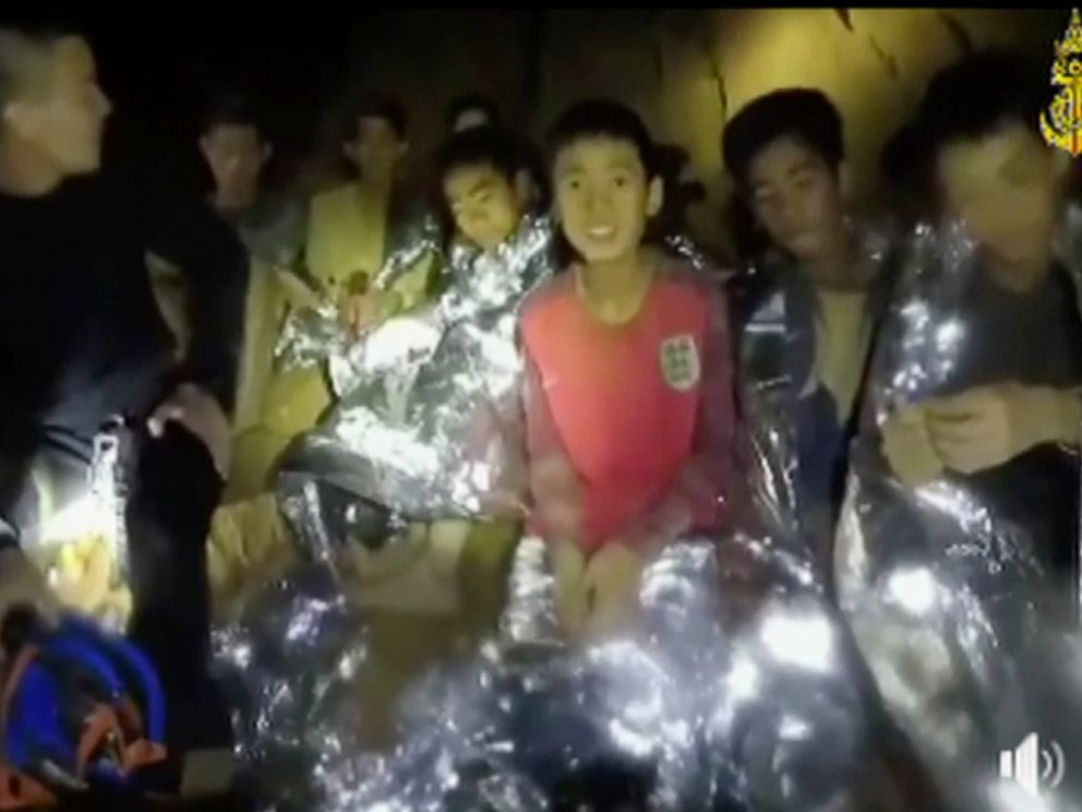 PHOTO: In this July 3, 2018, image taken from video provided by the Thai Navy Seal, Thai boys are with Navy SEALs inside the cave, Mae Sai, northern Thailand.