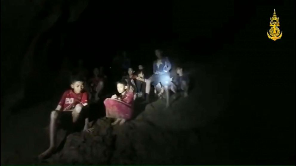 A light illuminates members of the soccer team found alive in a cave in Thailand as rescue workers locate the missing boys and their coach, July 2, 2018 in Khun Nam Nang Non Forest Park, Thailand.